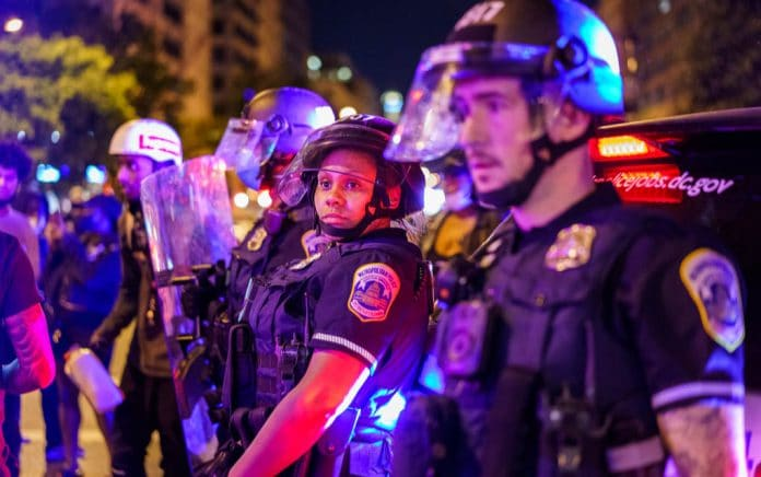 Police Show Unity with Protesters